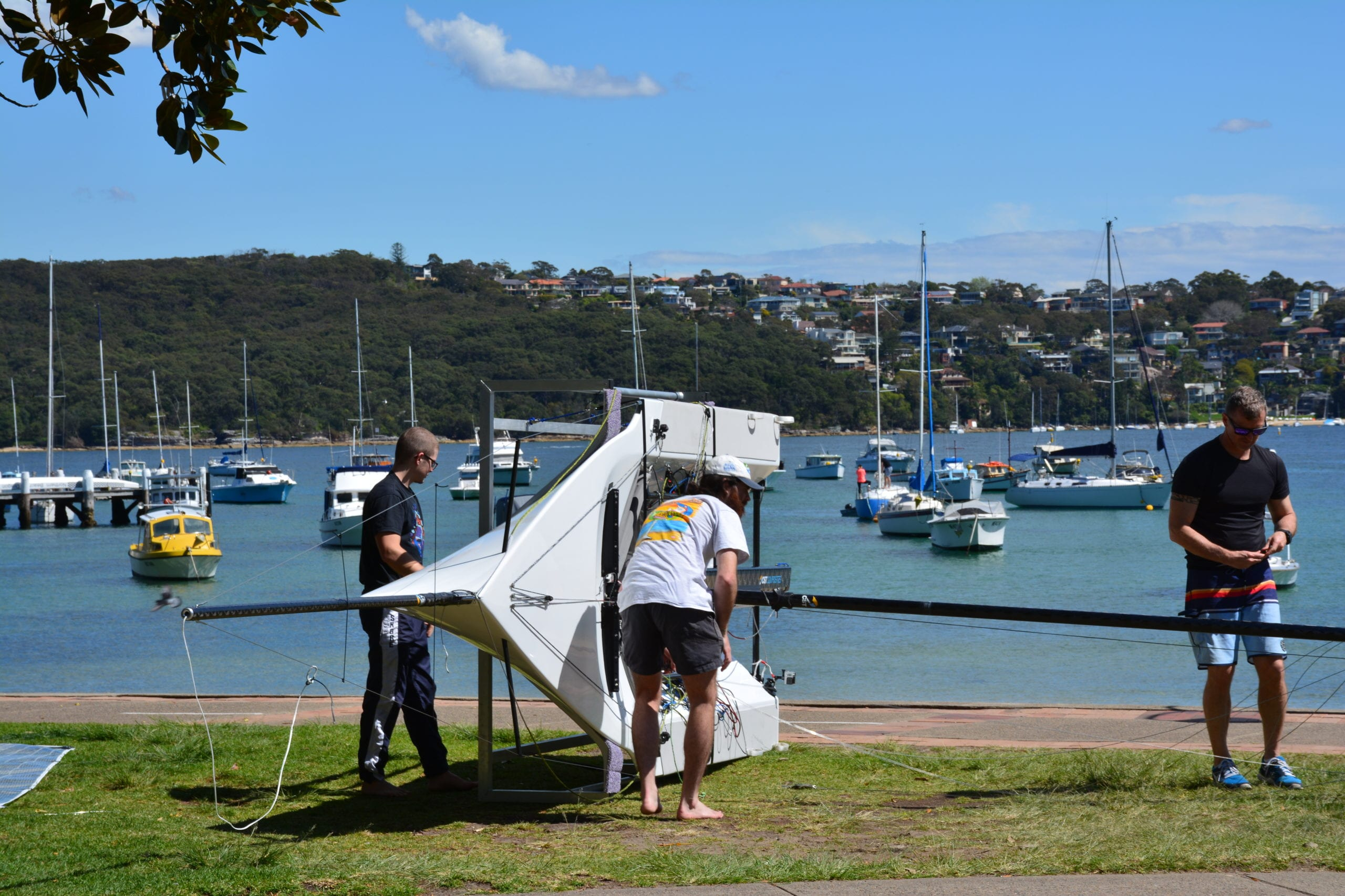 The sailors from Red Square Sailing Team getting their new boat ready in Manly.