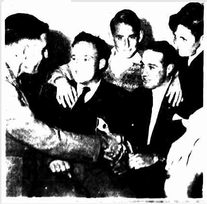 A photo showing Keith Reynolds and Kevin Curry, two of the rescuers, with the rescued man and two boys; a young Alberton man and a boy from Prospect and one from Largs Bay. Photo: The Mail, 18 April 1953
