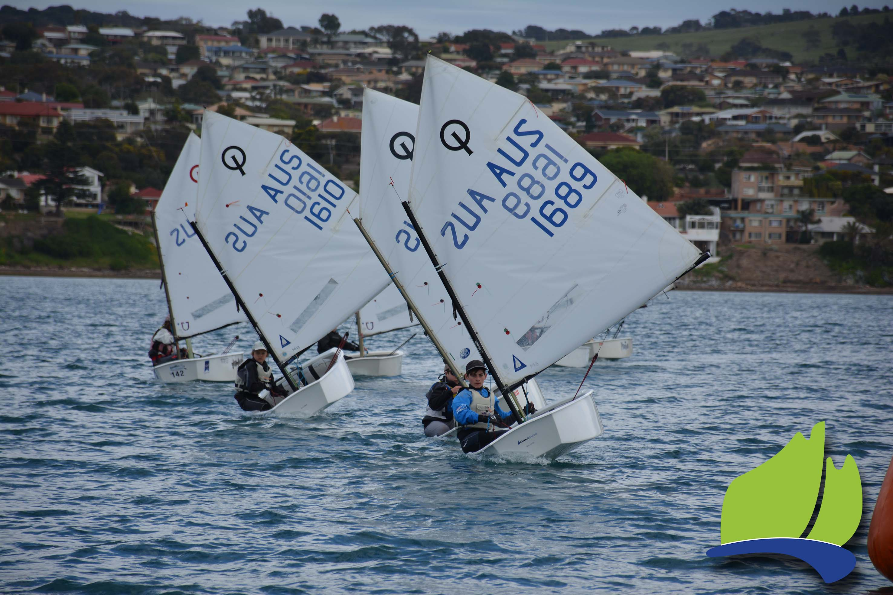 Alexi Wigglesworth leading the fleet in one of the optimist races.