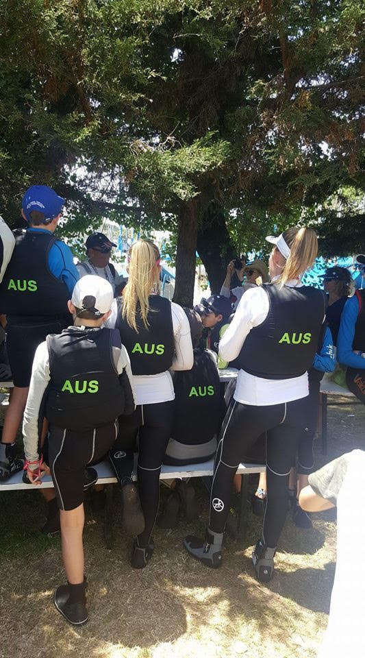 The Australian team getting briefed before a day of racing.