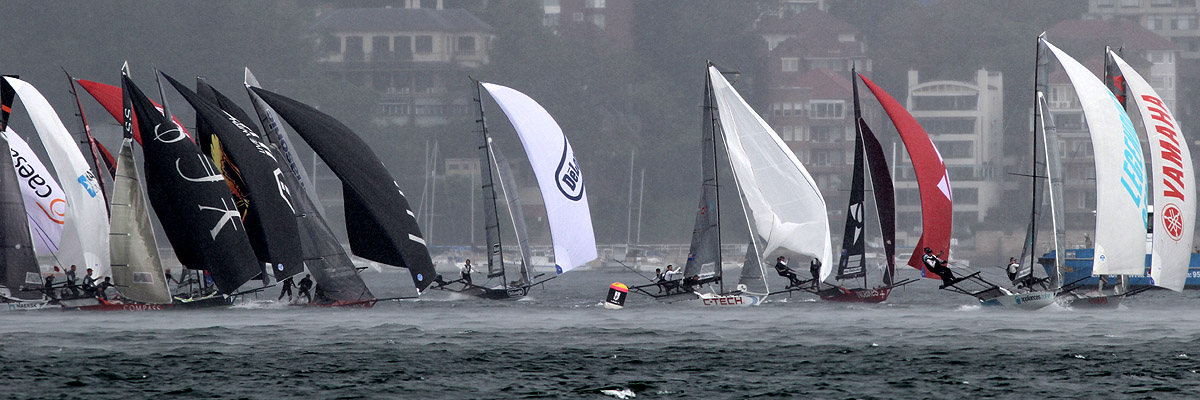 Action at the wing mark as the rain squall starts to hit