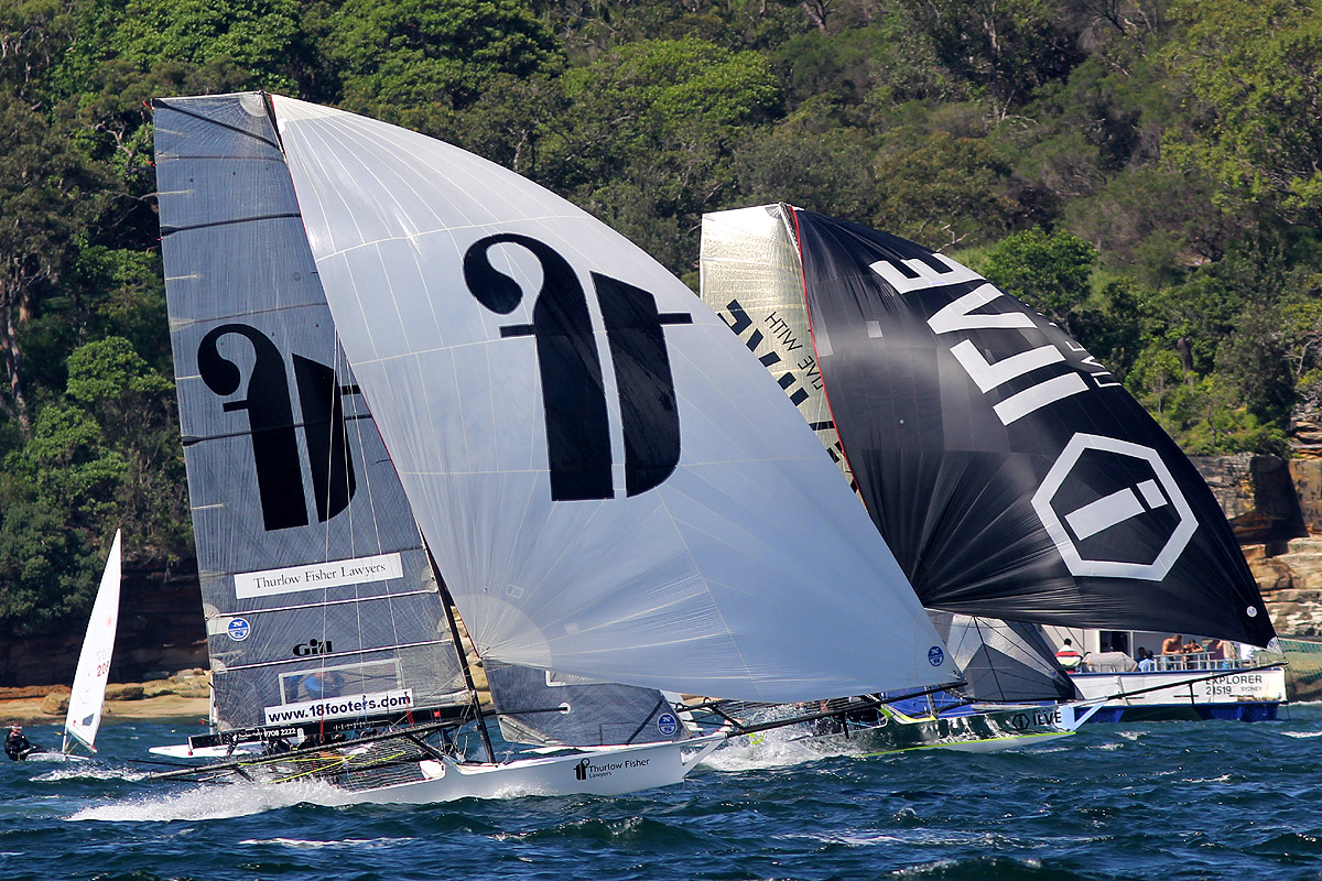 Thurlow Fisher Lawyers and Ilve side by side at top speed on the run into Rose Bay