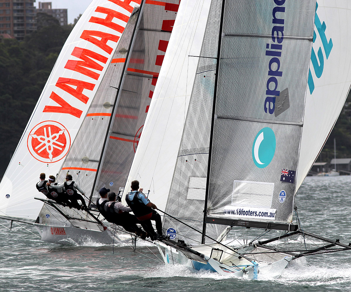Yamaha and appliancesonline in a tight spinnaker battle as they head for the bottom mark