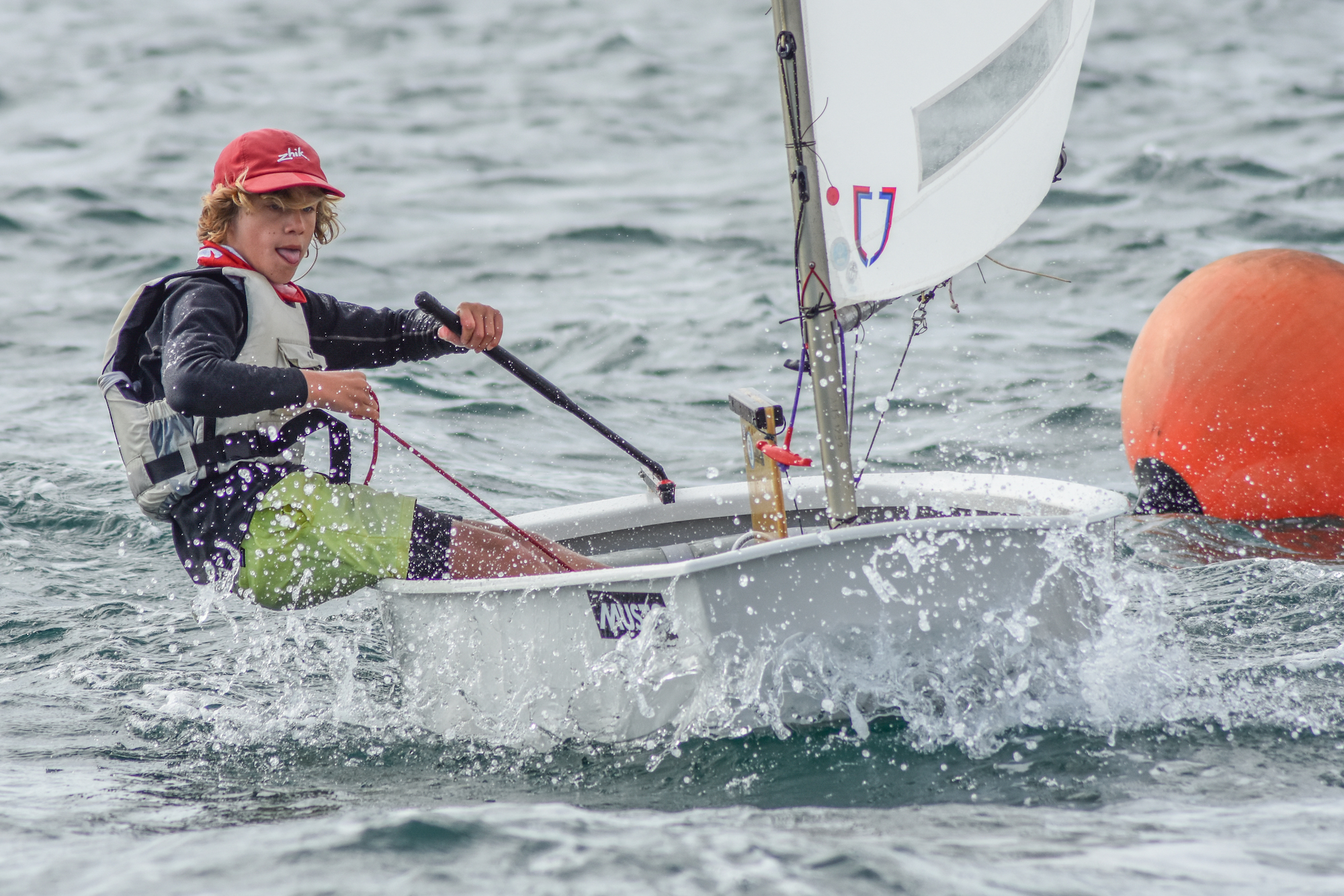 Fluky conditions kick off racing at Musto SA Optimist States