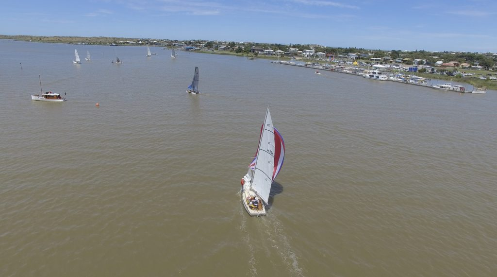 Boats finishing in front of the Goolwa Regatta Yacht Club.