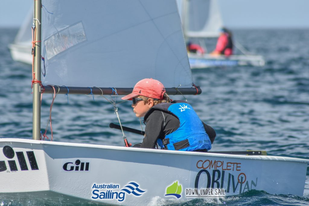 Ian Irwin in Complete Oblivion racing in the Optimist Open fleet.
