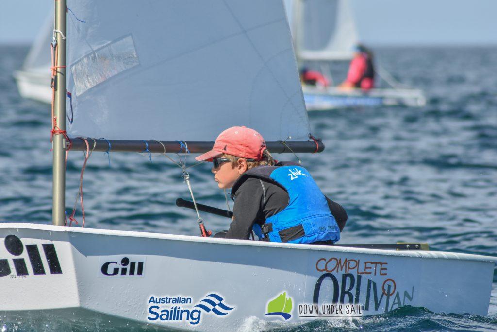 Ian Irwin in Complete Oblivion racing in the Optimist Open fleet.