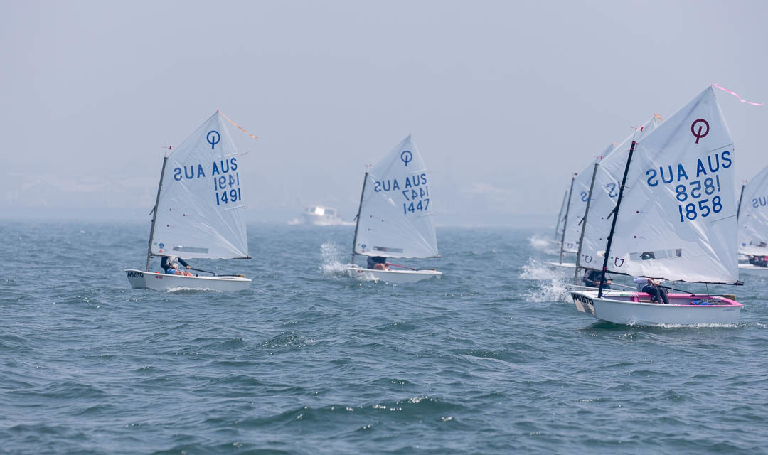 Light and fickle conditions in invitational race for 2020 Musto Optimist Australian Championships